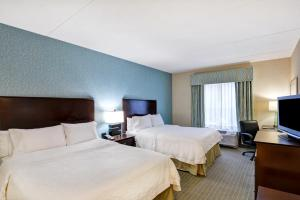 A bed or beds in a room at Hampton Inn & Suites Wilkes-Barre