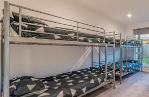 A bunk bed or bunk beds in a room at 7 Boardwalk Boulevard, Cowes