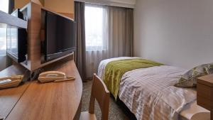 Tempat tidur dalam kamar di Fujinomiya Fujikyu Hotel