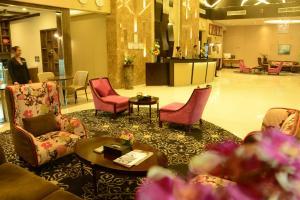 The lobby or reception area at Atiram Premier Hotel