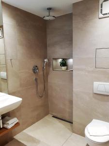 A bathroom at Apparthotel Garni Superior Simsseeblick