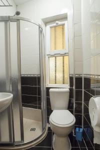 Ein Badezimmer in der Unterkunft Metropolis Hostel & Guest House