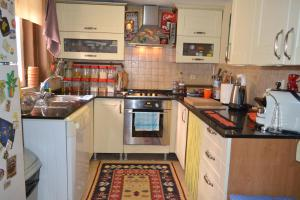 A kitchen or kitchenette at My Happy Home Hostel