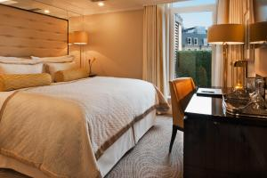 A bed or beds in a room at The Wellesley, a Luxury Collection Hotel, Knightsbridge, London