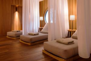 A bed or beds in a room at Faloria Mountain Spa Resort