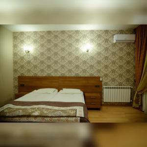 Cama ou camas em um quarto em Deyirman Hotel