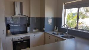A kitchen or kitchenette at Santalina On Hervey Bay