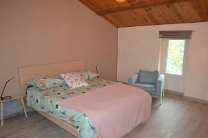 A bed or beds in a room at B&B Le Relais de Joseph