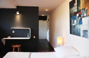 A bed or beds in a room at Hotel & Restaurant Weidumerhout