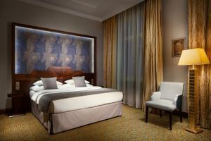 Postel nebo postele na pokoji v ubytování Art Deco Imperial Hotel
