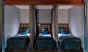 A bed or beds in a room at The Midland