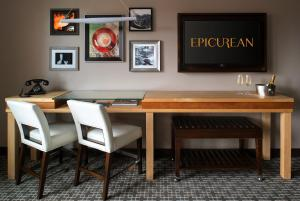 A television and/or entertainment center at Epicurean Hotel, Autograph Collection
