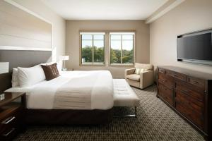 A bed or beds in a room at Epicurean Hotel, Autograph Collection
