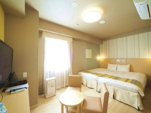 A bed or beds in a room at Hiyori Hotel Maihama