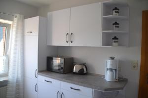 Küche/Küchenzeile in der Unterkunft Grensemann, Ferienwohnung
