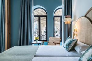 A bed or beds in a room at Hotel Casa de Indias By Intur
