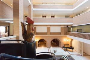 El vestíbulo o zona de recepción de Hostellerie Du Cheval Blanc