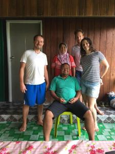A family staying at Osman's Homestay