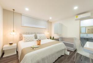 Llit o llits en una habitació de Medellín Vibes Hostel