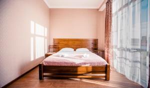 Кровать или кровати в номере Мини-отель Аида