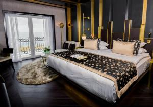 A bed or beds in a room at Rocks Hotel & Casino