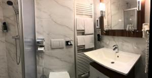 Ванная комната в Hotel König