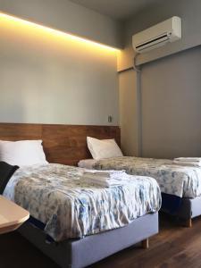 Кровать или кровати в номере Blue Sky