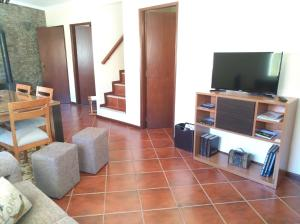 A television and/or entertainment center at Casa D. Antónia