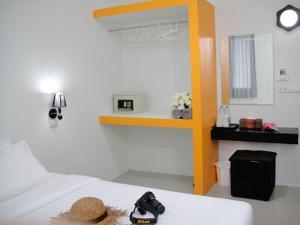 Ein Bett oder Betten in einem Zimmer der Unterkunft Harmony Bed & Bakery