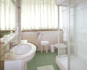 A bathroom at ALA Hotel
