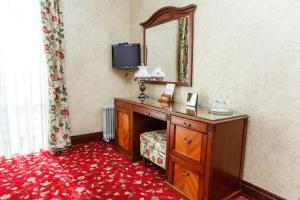 Телевизор и/или развлекательный центр в Парк-отель Вознесенская Слобода