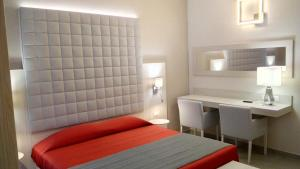 A bed or beds in a room at Hotel Bel Soggiorno