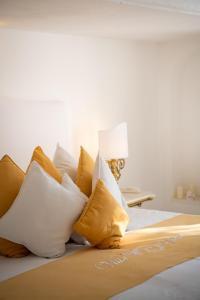 Letto o letti in una camera di Villa Yiara