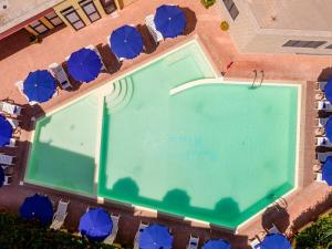 A view of the pool at Rina Hotel or nearby