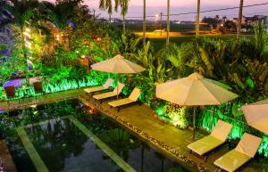 A view of the pool at Hoi An Golden Rice Villa or nearby