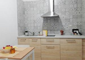 A kitchen or kitchenette at La Dimora dei Longobardi Studio Apartment