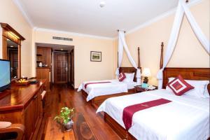 Pacific Hotel & Spaにあるベッド