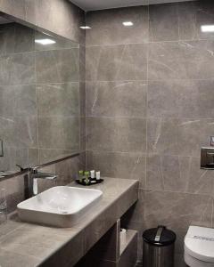 Ванная комната в Palatino Hotel