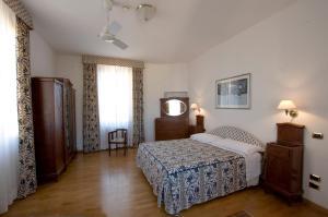 Кровать или кровати в номере Albergo Italia
