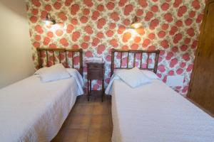 A bed or beds in a room at Casa Batlle