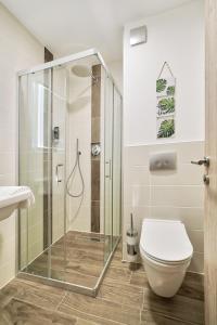 Ein Badezimmer in der Unterkunft Hotel Tiffany