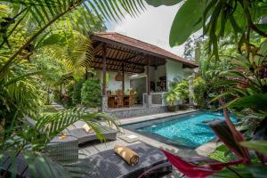The swimming pool at or close to Villa Alam Surya Ubud