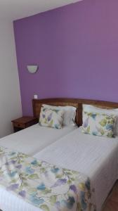 A bed or beds in a room at Paisagem do Guadiana Turismo Rural