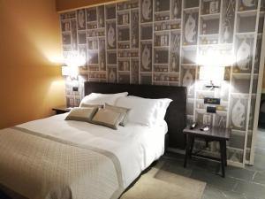 Letto o letti in una camera di Grand Hotel San Marino