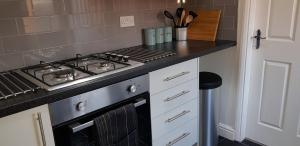 A kitchen or kitchenette at Maplewell House