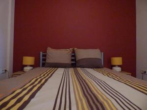 Een bed of bedden in een kamer bij De Alpacaboerderij