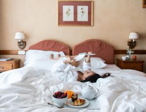 Letto o letti in una camera di QC Termemontebianco