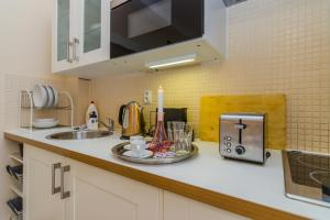 Cucina o angolo cottura di Old Town Studio Apartment