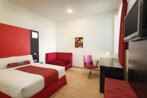 A bed or beds in a room at Ramada Encore Doha