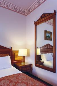 A bed or beds in a room at Golden Tulip Serenada - Boutique Hotel